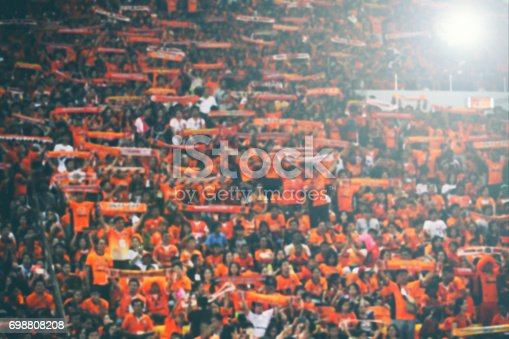 istock blurry of Soccer fans in a match and Spectators at football stadium 698808208