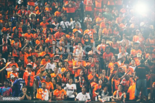 istock blurry of Soccer fans in a match and Spectators at football stadium 698808432