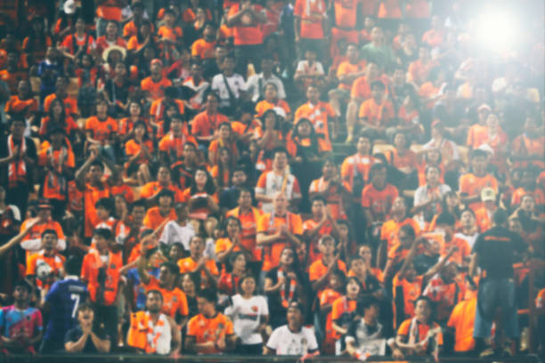 blurry of Soccer fans in a match and Spectators at football stadium stock photo