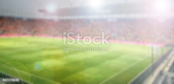 istock blurry of Soccer fans in a match and Spectators at football stadium is a public sports facility 942476046