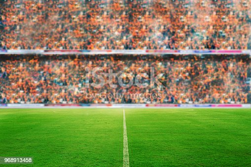 istock blurry of Soccer fans in a match and Spectators at football stadium 968913458