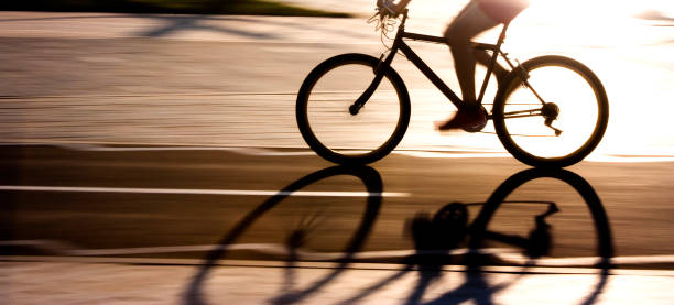 Blurry panning silhouette and shadow of a cyclist
