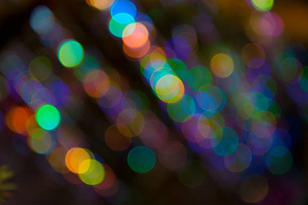 blurry pattern of colorful decoration lights - disco lights stock photos and pictures