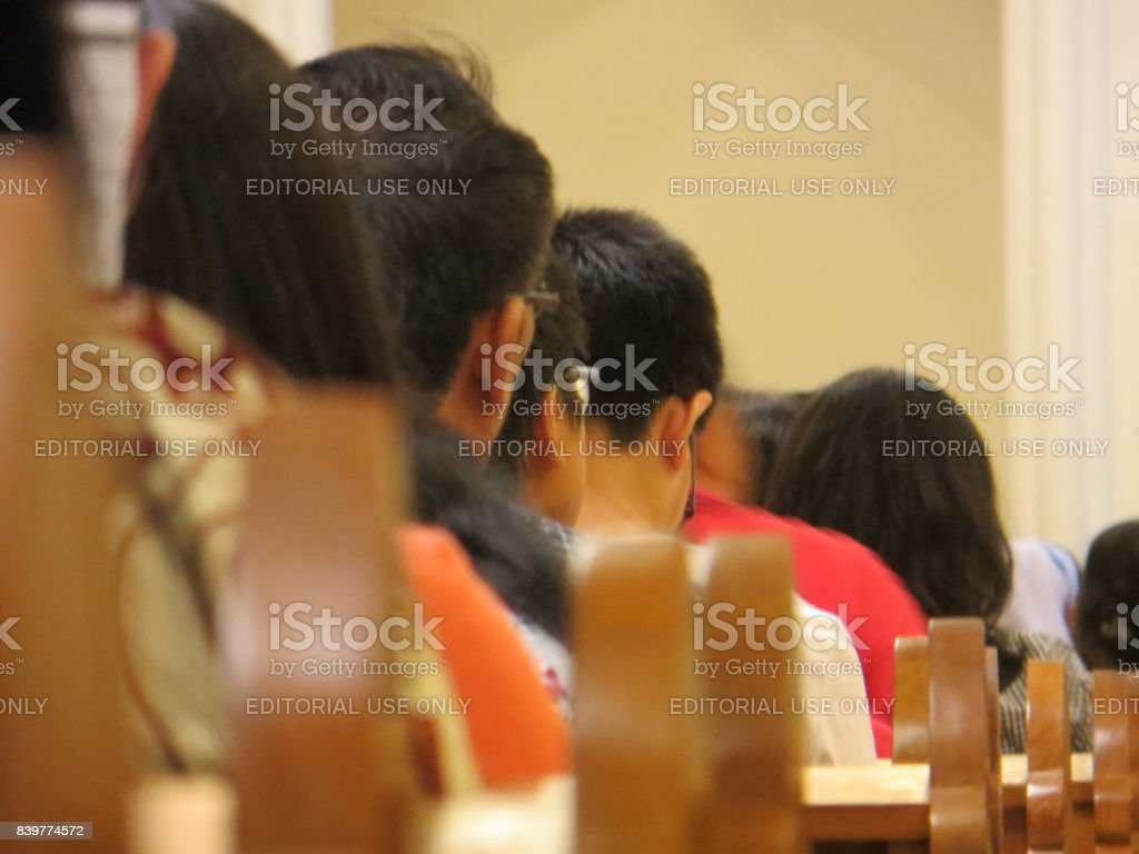 Blurry people at church. stock photo