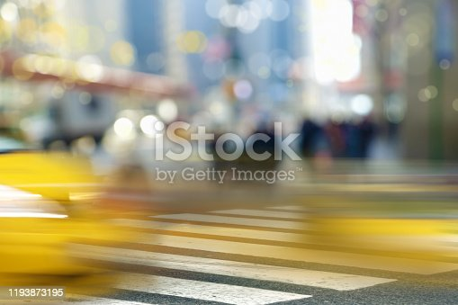 813211754 istock photo blurry people on Manhattan street 1193873195