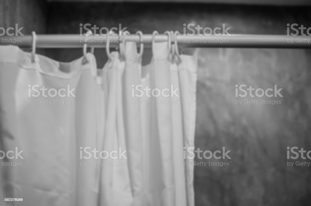 blurry photo of shower curtain black and white tone stock photo