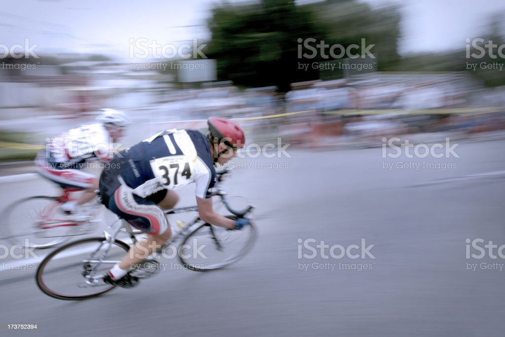 Blurry photo of two men in a bicycle race stock photo