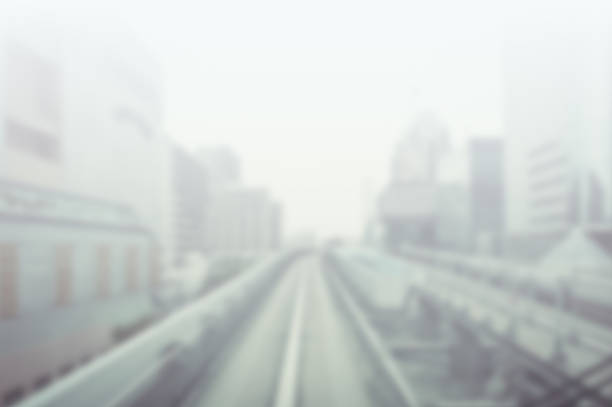 Blurry photograph of train tracks and skyscrapers stock photo