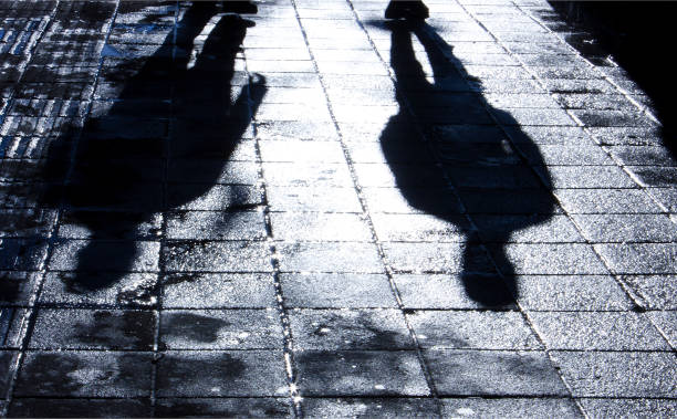 Blurry shadow and silhouette of two men standing in the night