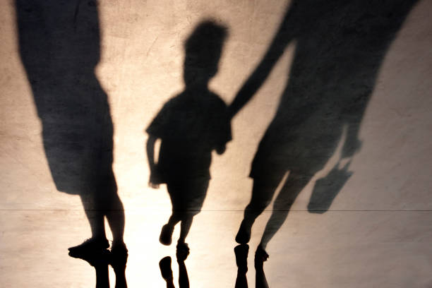 blurry shadow of two person and a kid - separation stock photos and pictures