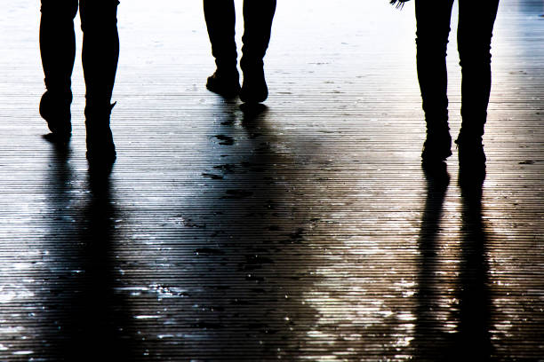 Blurry shadow silhouette of a people walking in the night, detail