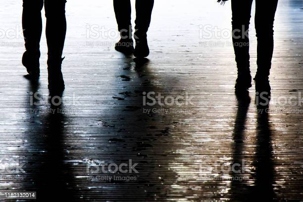 Photo of Blurry shadow silhouette of a people walking in the night, detail