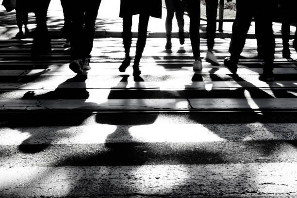 blurry shadows and silhouettes of people on crossroad - high contrast stock pictures, royalty-free photos & images