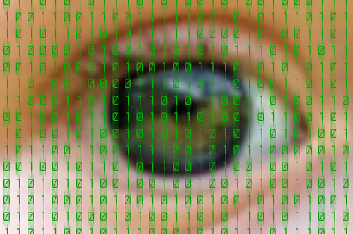 510584002 istock photo Blurry shot of eye overlaid with binary code 180250809