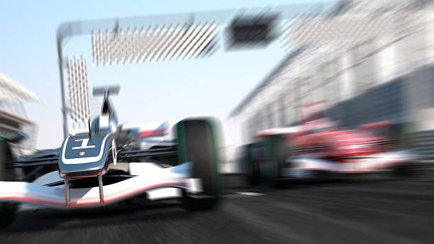 Blurry, speeding formula 1 car race stock photo
