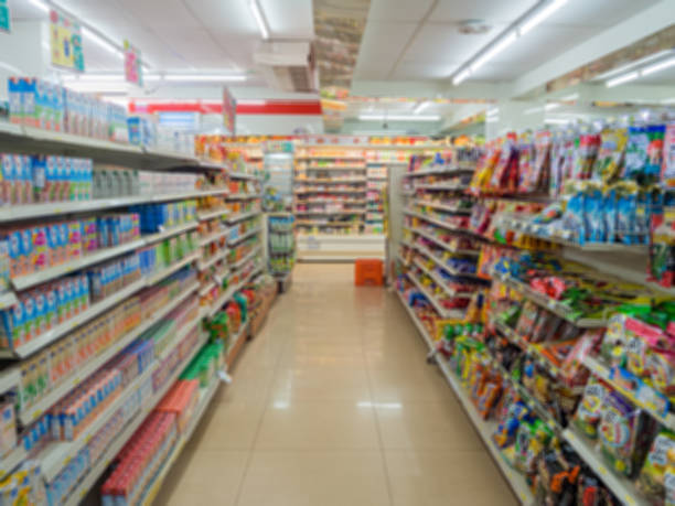 Blurry Supermarket The Shelves Convenience Store (7-11) at Thamai at Chanthaburi, Thailand convenience stock pictures, royalty-free photos & images