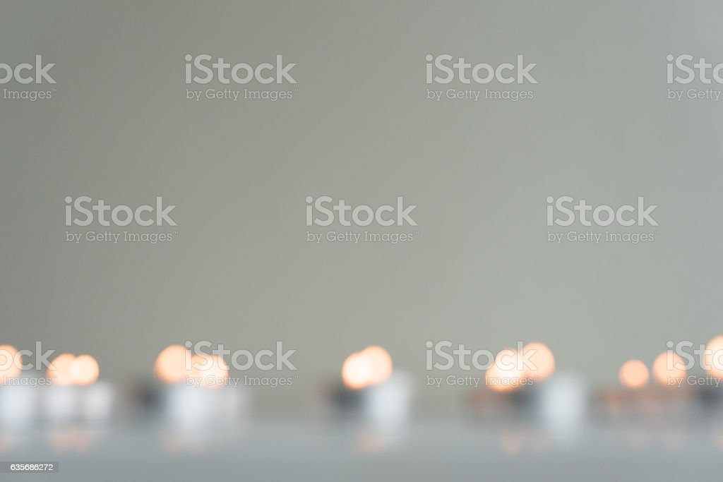 Blurry tealights on table stock photo