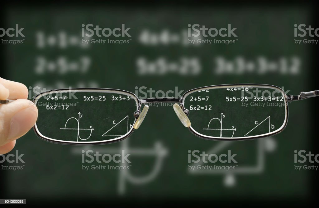 blurry vision of a chalkboard corrected by the glasses stock photo