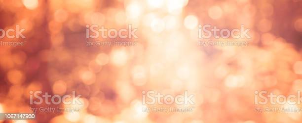 Photo of blurry yellow leaves nature forest landscape background with sunlight flare:blurred bokeh natural backdrop