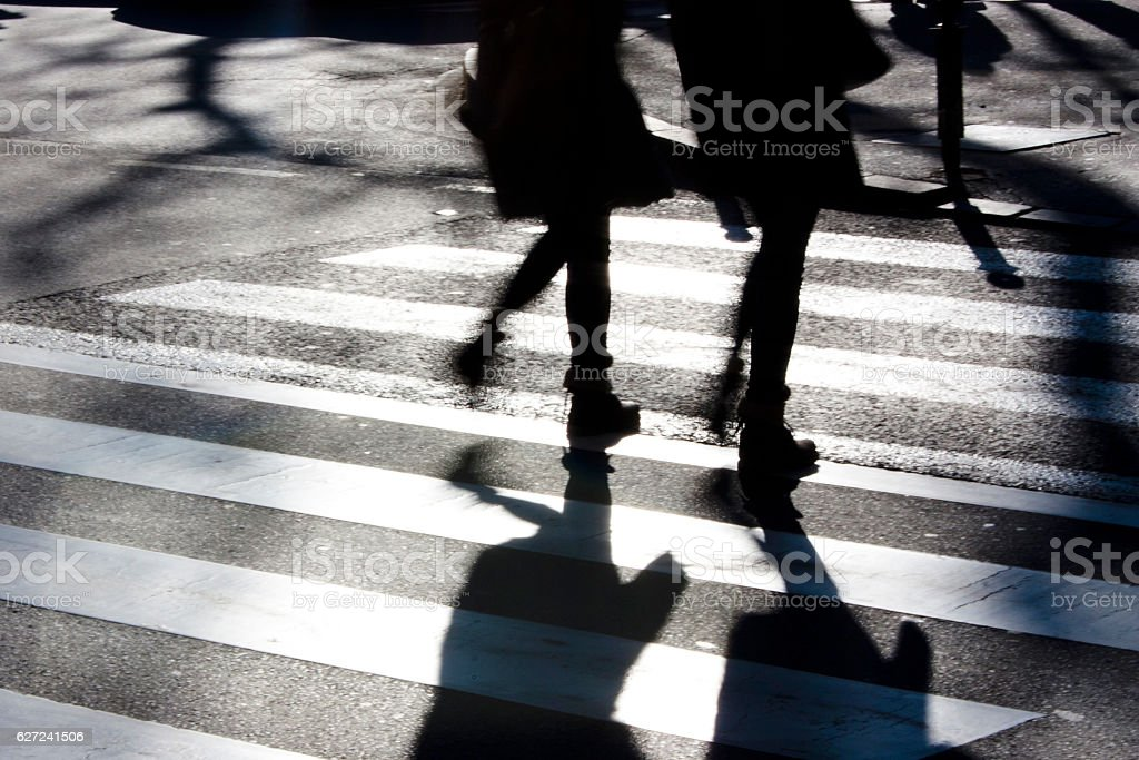 Blurry zebra crossing with pedestrians stock photo