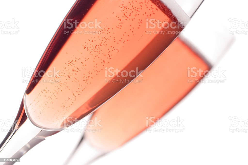 Blush champagne in fluted glasses against a pale background stock photo