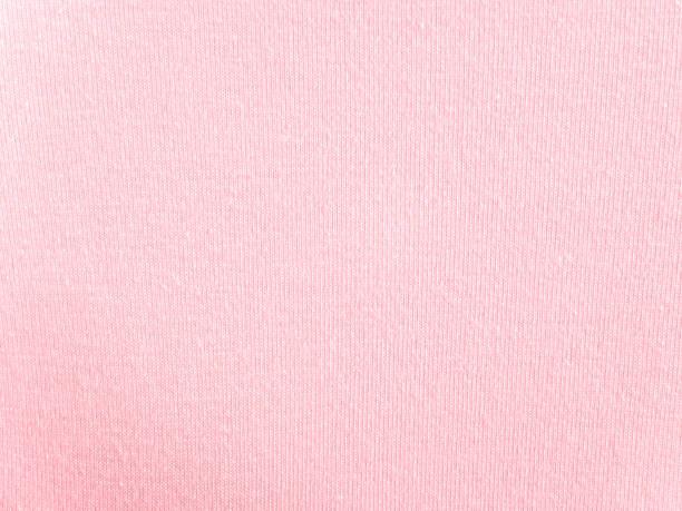 Blush pink cotton knitwear fabric texture stock photo
