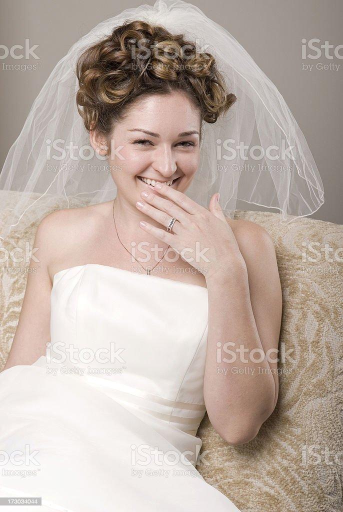 Blushing Bride Smiles Towards Camera stock photo