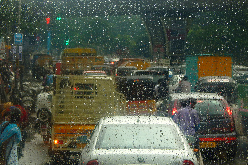 Bluured photo of Indian road traffic during rain