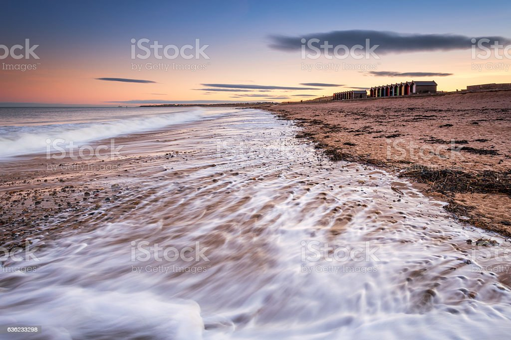 Blyth Beach retreating waves stock photo