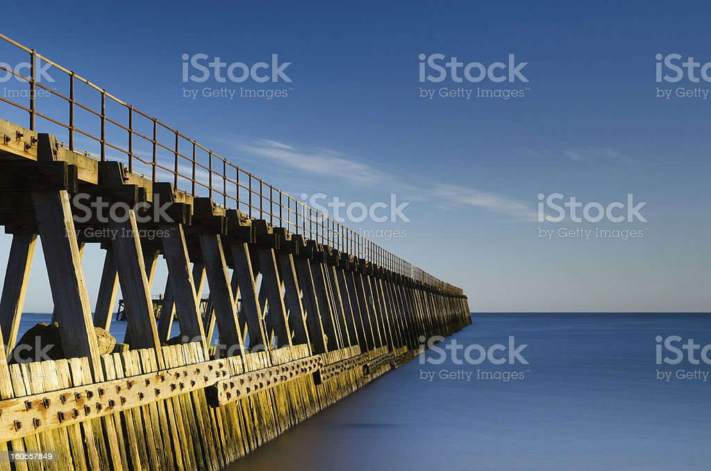 Blyth pier in smooth water royalty-free stock photo