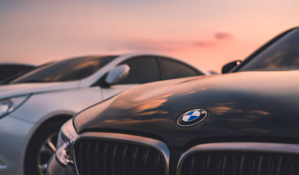 bmw car on sunset sky. august 20 in 2018, seoul in south republic korea. bmw car on sunset sky. bmw is germany vehicle company in global. vehicle brand name stock pictures, royalty-free photos & images