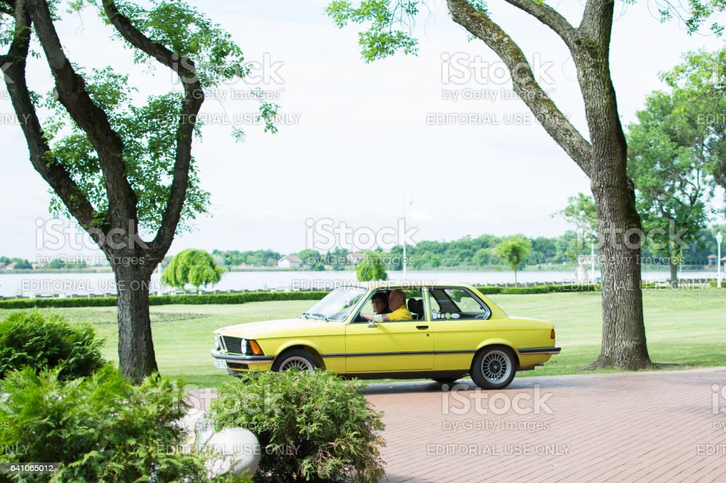 Bmw car on the move, driving in park stock photo
