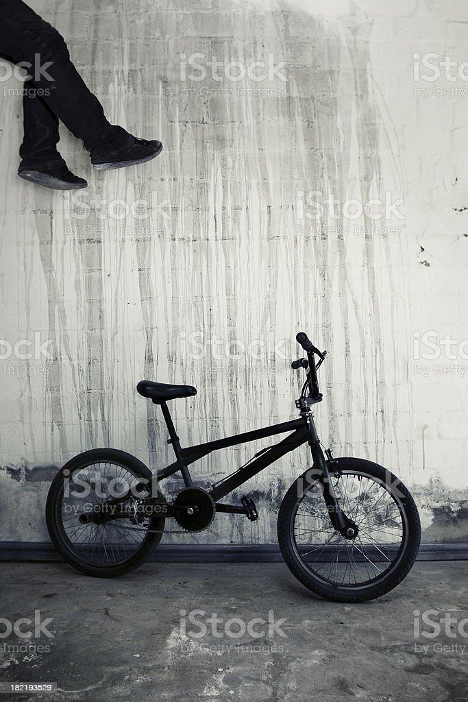 bmx against textured wall with floating rider royalty-free stock photo