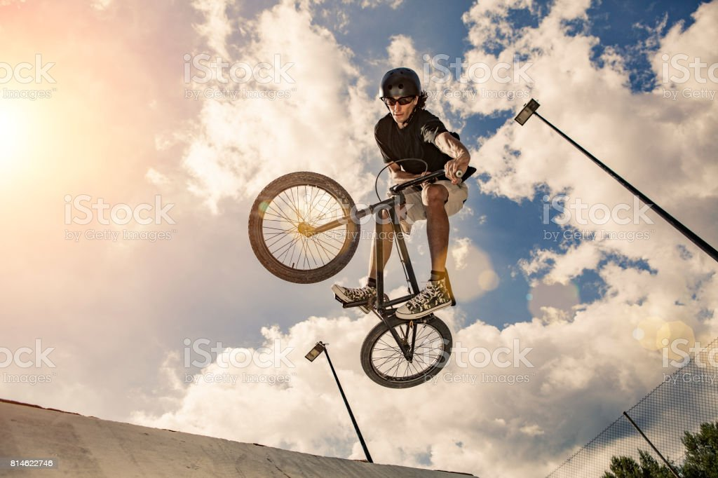 Bmx cyclist jumping Real jump stock photo