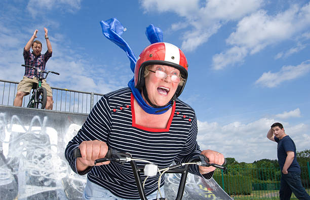 bmx granny - daredevil stock pictures, royalty-free photos & images