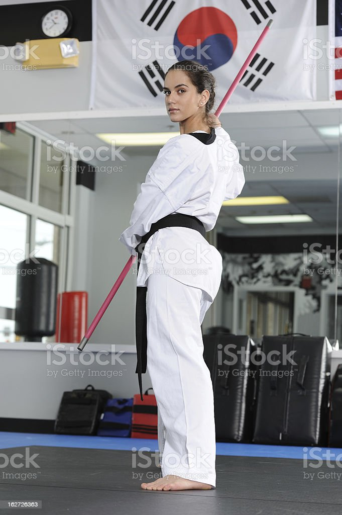 Bo Staff Training In The Dojang Stock Photo - Download Image Now