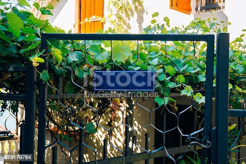 1058533662 istock photo Board for inscriptions on the wall of a building 675179784