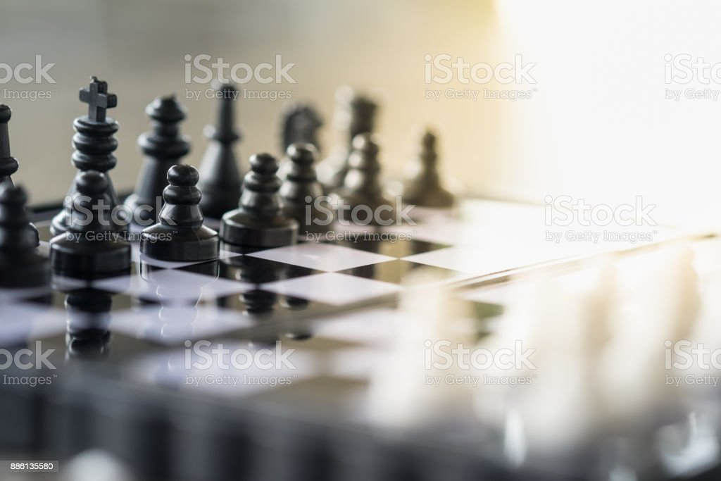 Board game, business and planning concept. Close up of black and white chess pieces on chessboard stock photo
