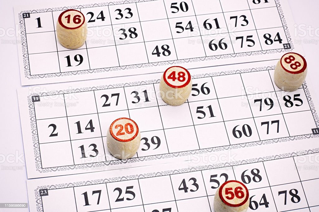 board game lotto, cards with numbers for the game, kegs are on the...