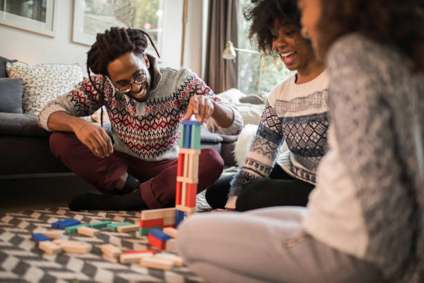 Board games bring  family together stock photo