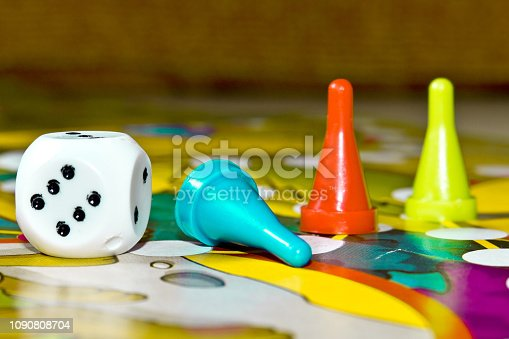 istock Board games for the home. Yellow, green and red plastic chips and dice on Board games for children 1090808704
