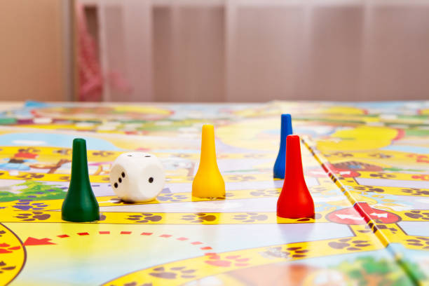 Board games for the home. Yellow, green and red plastic chips and dice on Board games for children . Selective focus stock photo
