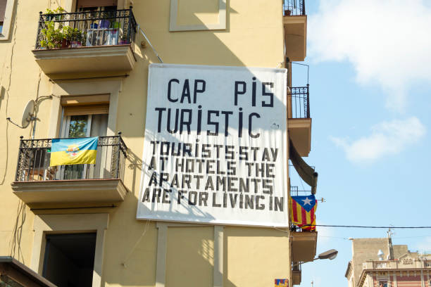 Board hanging on a balcony made by neighbours of Barceloneta hood in Barcelona, complaining of holiday apartments and turism's overpopulating in Barcelona stock photo
