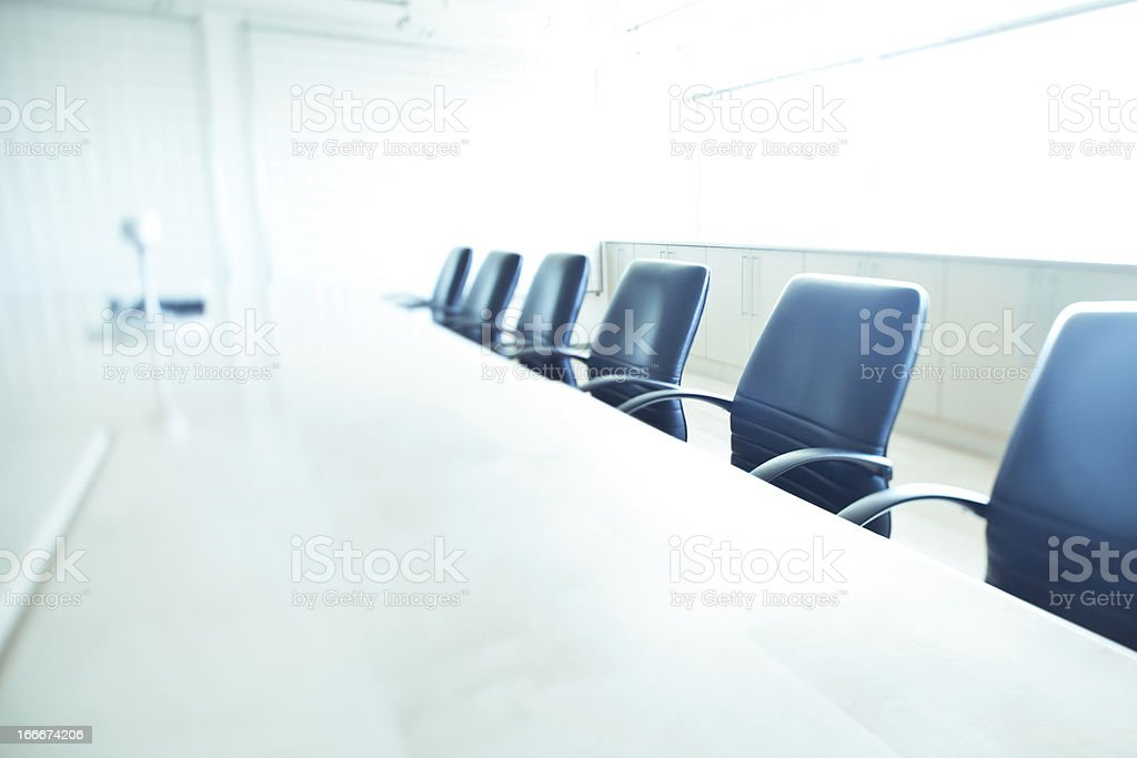 Board room filled with empty table and chairs stock photo