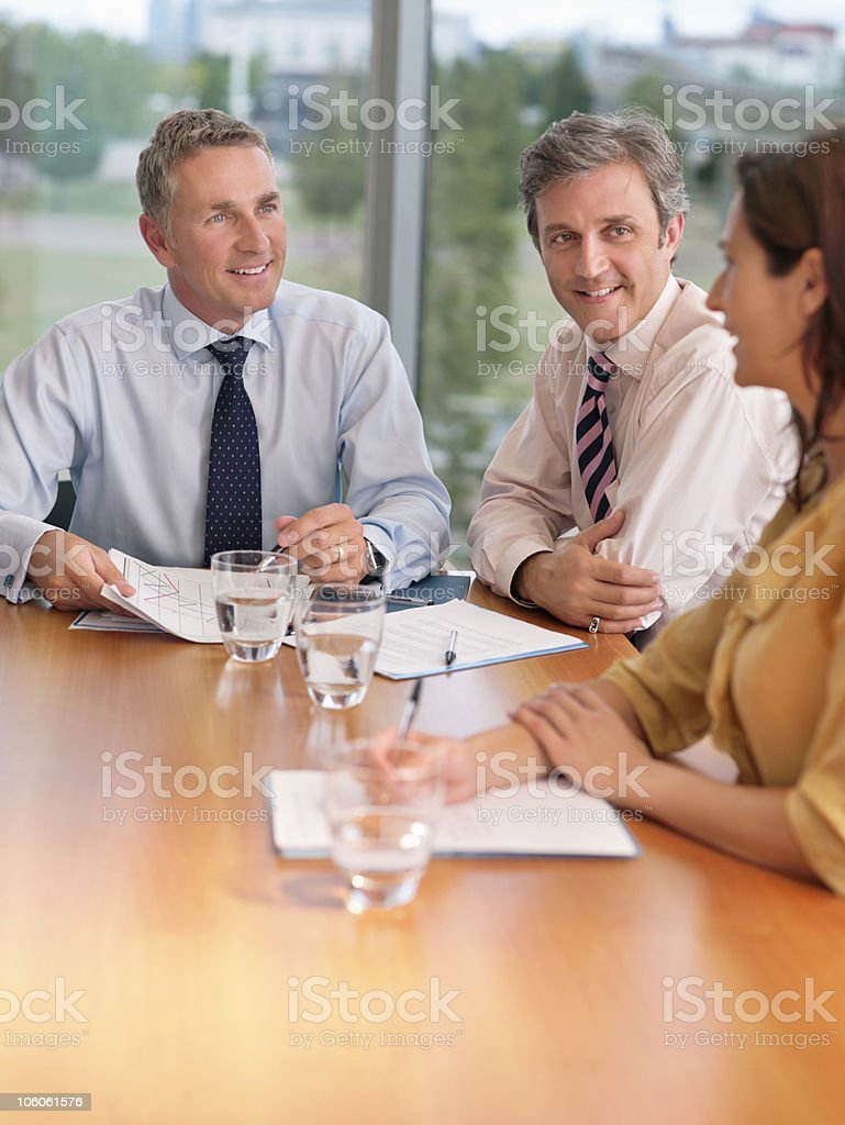 Board room meeting of three business executives royalty-free stock photo