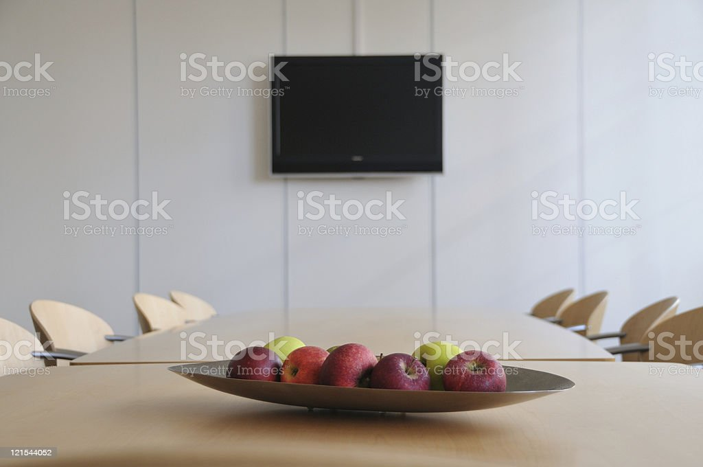 Board room with empty chairs and fresh fruit stock photo