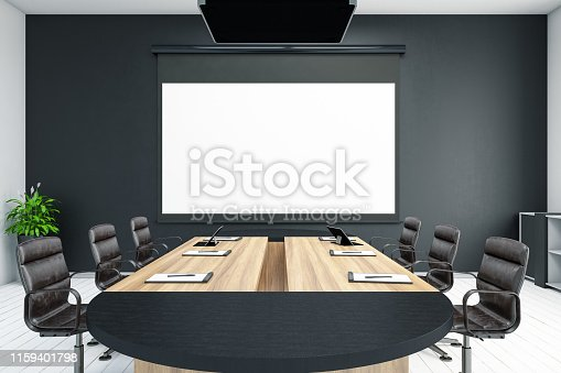 istock Board Room with Empty Projection Screen 1159401798