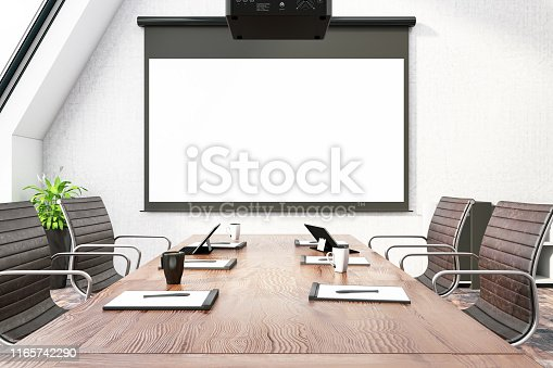 istock Board Room with Empty Projection Screen 1165742290