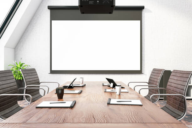 Board Room with Empty Projection Screen stock photo