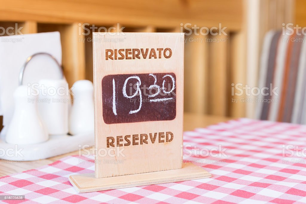 Board with reservation information in restaurant stock photo
